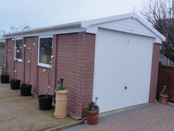 Concrete garage in brick finish Prefab workshops garages
