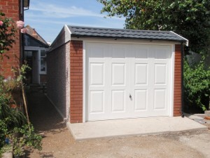Concrete Garage designed with Grey Mansard roof